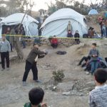 Refugees playing ball in Moria camp in Lesvos, Greece