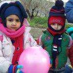 Refugees kids playing balloon in Lesvos, Greece