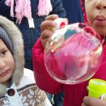 Kids playing bubbles at Moria camp in Lesvos, Greece