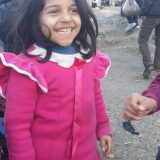 Refugee kid smiling in Lesvos, Greece