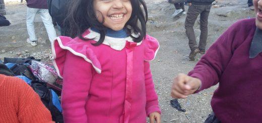 Refugee kid smiling in Lesvos, Greece